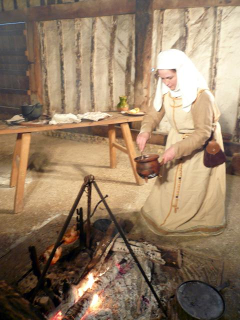 Medieval cook stirring a sauce.