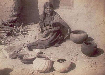 Ancient Hopi woman making pottery