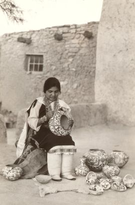 Pueblo Indian Woman decorating Pottery