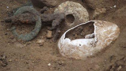 Cowrie shell & Trinkets found at River Alde Suffolk