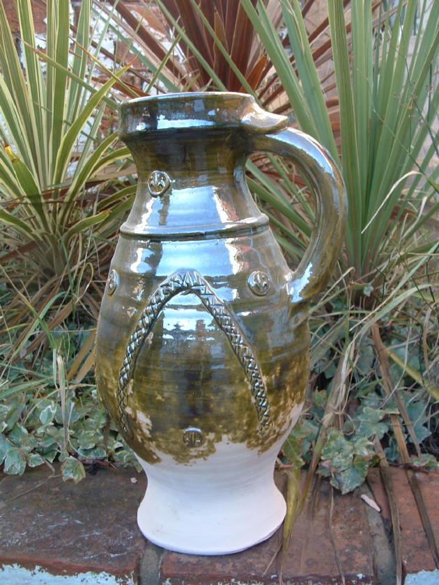Medieval green glazed jug