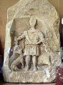 Chedworth stone carving of Hunter with stag,